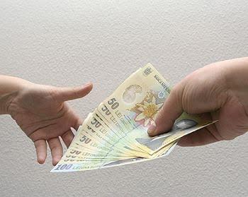 De la 1 iulie 2015, salariul minim pe economie ajunge la 1050 de lei