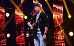 Un chinez care cântă pe stradă în București a ajuns pe scena X Factor